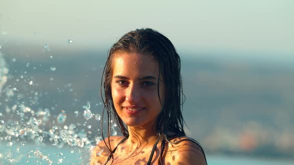 Thumbnail for Water splashing on a young woman's face, Ultra Slow Motion