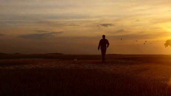 Thumbnail for Young Camper Walking in Empty Field at Sunset