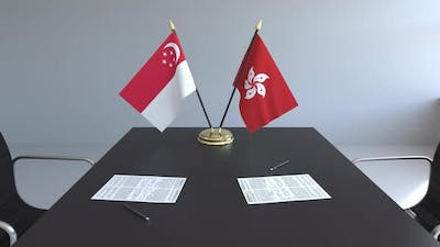 Flags of Singapore and Hong Kong on the Table