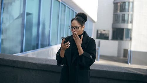 African American Woman Gots Message Surprise Reads Stunning News on Mobile Phone