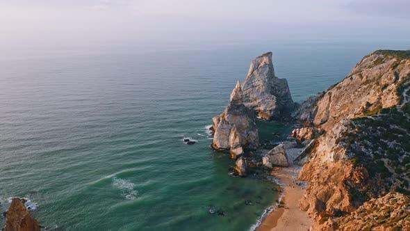 Thumbnail for Aerial View of Rocky Praia Da Ursa Beach Located on Atlantic Coast in Sintra Region, Portugal
