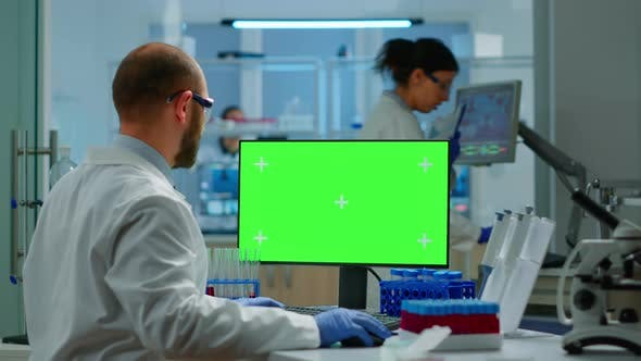 Researcher Looking at Chroma Key Display in Modern Equipped Lab