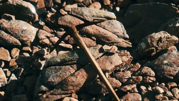 Retro Pickax on the Rocks