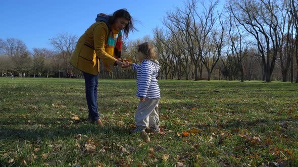Thumbnail for Mother And Baby Playing In A Beautiful Autumn Park