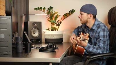 Musician playing acoustic guitar. Guitarist playing guitar.