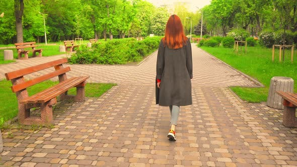 Thumbnail for Red-Haired Girl Turned Back Walks By Road