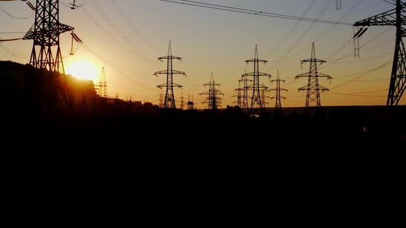 High voltage post at sunset. High voltage towers with electrical wires