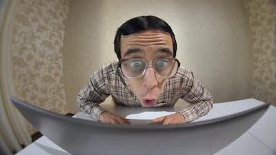 Surprised Nerd Working on Laptop