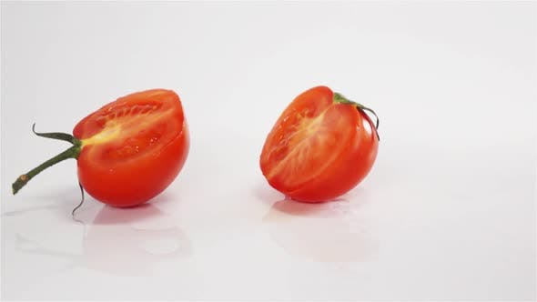 Cover Image for Two Halves of Tomato Breaks Hitting White Surface