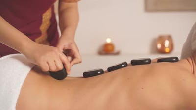 Back Massage Helping Relieve Muscle Tension and Pain.