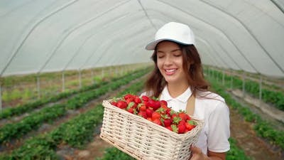 Woman in Special Clothes Holding Basket with Strawberries