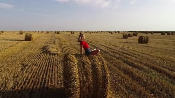 Thumbnail for Girl On Hay Bales
