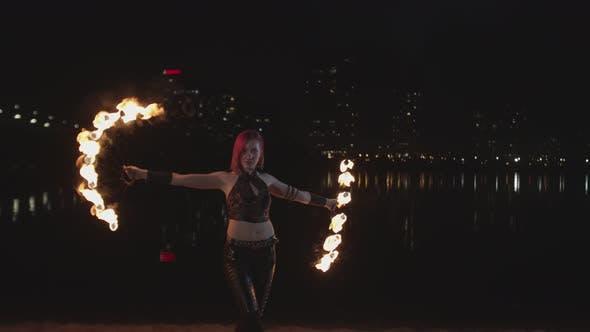 Pretty Firegirl Performing Art of Spinning Fans