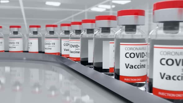 Vaccine Bottles on the Conveyor Production Line Ready To Vaccination Injection