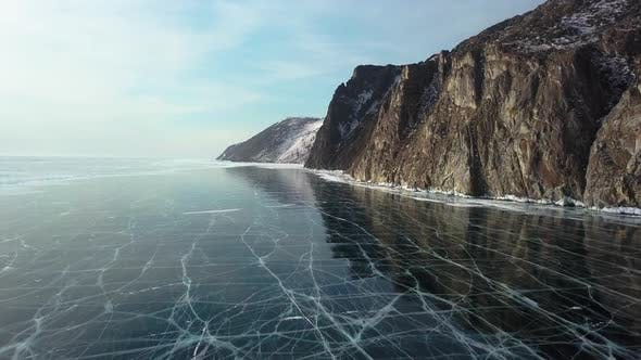 Thumbnail for Ice with Cracks in Lake Baikal in Winter. Sagan-Zaba Cliff, Aerial View.