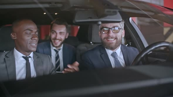 Thumbnail for Laughing Business Partners in Car