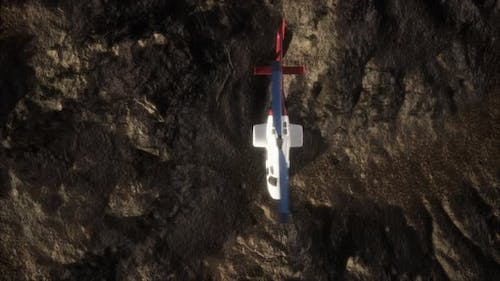 Slow Motion Helicopter Above Rocky Desert