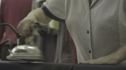 Hands ironing