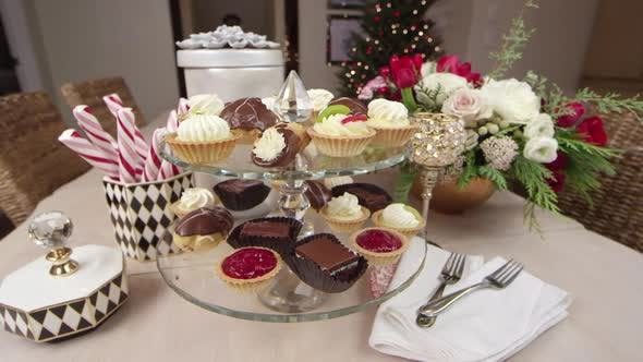 Thumbnail for An assortment of delicious desserts decoratively displayed for a Holiday/Christmas party