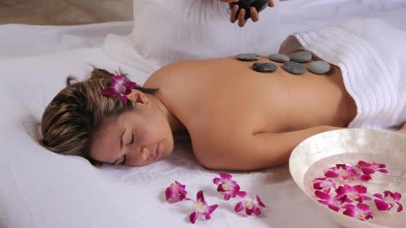 Thumbnail for Woman gets hot stone spa treatment