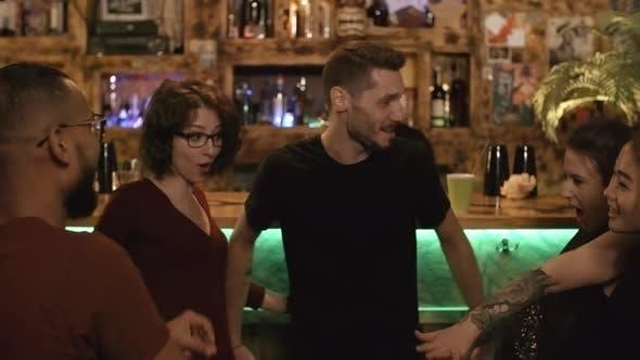 Thumbnail for Cheerful Friends Having Fun at Bar