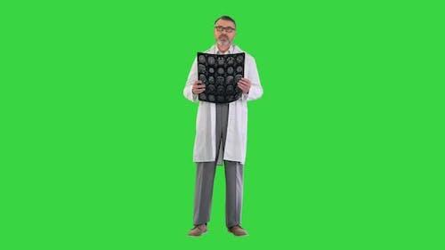 Senior Medical Doctor Looking At Mri on a Green Screen Chroma Key