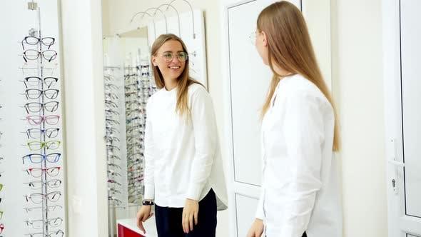 Thumbnail for Woman shopping for eyeglasses. Pretty girl trying eyeglasses at store
