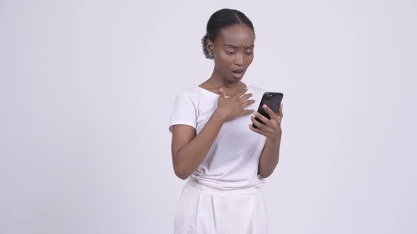 Thumbnail for Young Stressed African Woman Using Phone and Getting Bad News