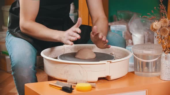 Thumbnail for Pottery - the Master Is Begining To Mold Clay on the Potter's Wheel
