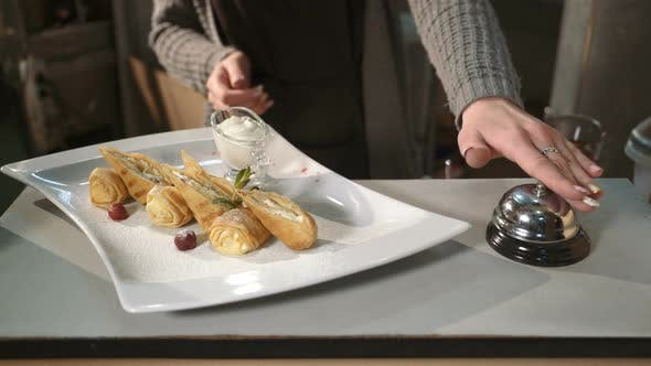 Thumbnail for Waiter Serving Plate of Dessert