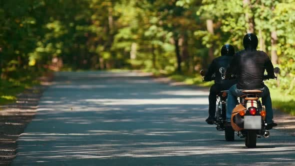 Thumbnail for Two Adult Men Motorcyclists Riding Motorbikes in the Forest at the Bright Sunny Day
