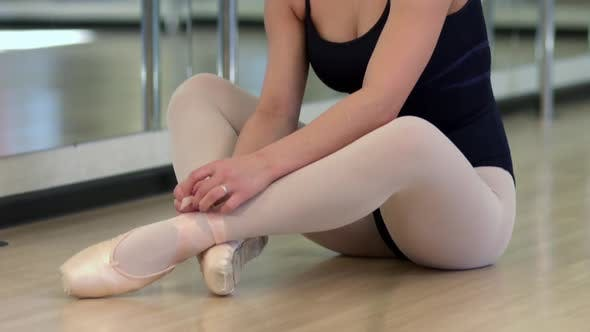 Thumbnail for Ballerina Sits On The Floor And Puts On Pointe