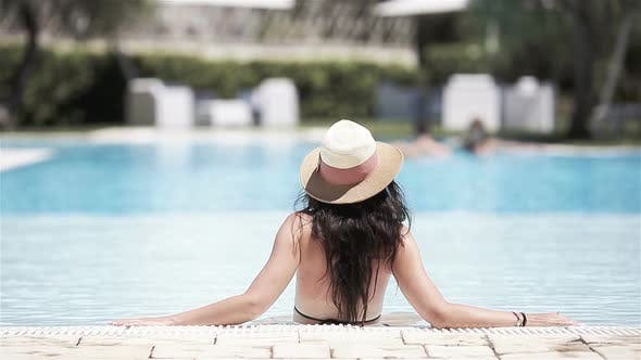 Thumbnail for Beautiful Young Woman Relaxing in Swimming Pool.