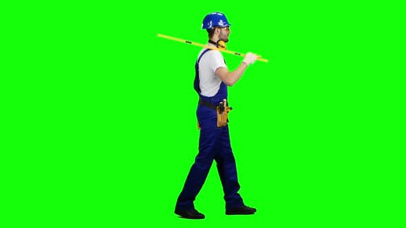 Thumbnail for Engineer with a Spirit Level in His Hands Goes To the Building Measurements. Green Screen. Side View