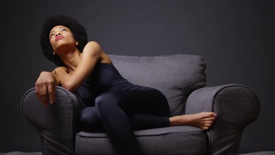 Thumbnail for Black woman sitting in armchair