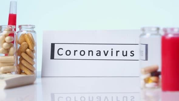 CORONAVIRUS Inscription Plate on the Background Are Pills a White Background. Novel Coronavirus