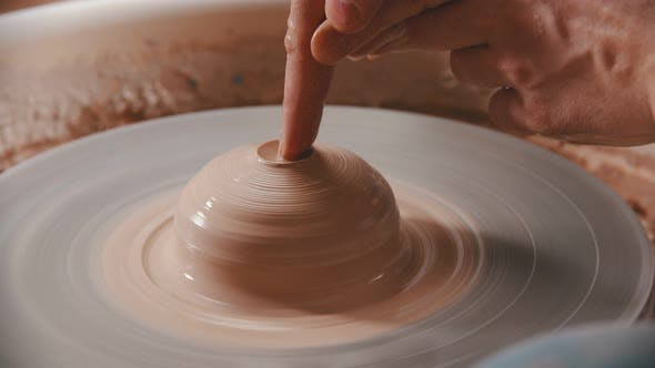 Cover Image for Pottery - the Master Is Pressing the Index Finger Into the Clay
