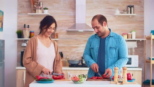 Thumbnail for Couple Chopping Tomatoes