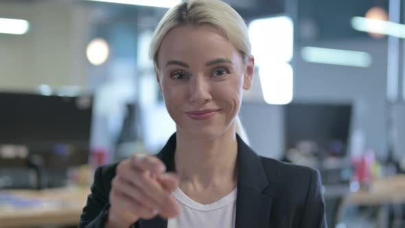 Thumbnail for Portrait of Cheerful Businesswoman Pointing Finger at the Camera and Inviting