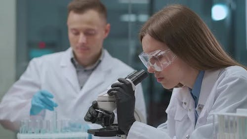 Team of Health Professionals Is Working in Research Laboratory of Scientific Institution, Male and