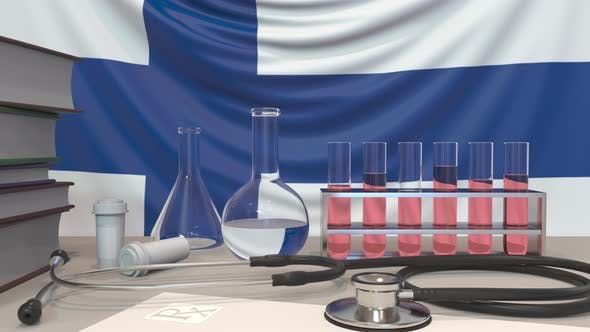 Cover Image for Clinic Laboratory Equipment on Finnish Flag Background