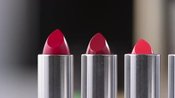 Thumbnail for Close Up Shot of Various Red Lipsticks on Makeup Table