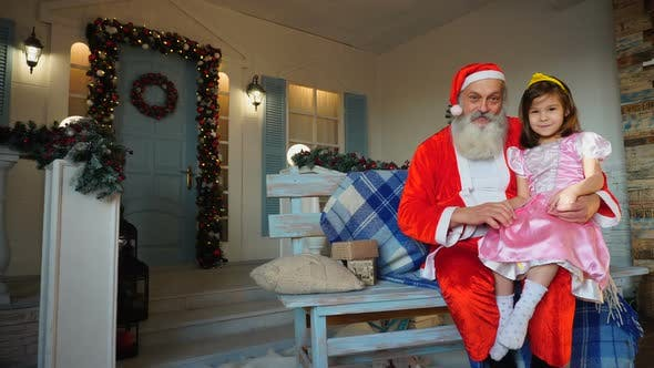 Thumbnail for Cheerful Santa Claus Talking To Little Girl.