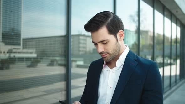 Thumbnail for Closeup Businessman Walking Outdoor. Businessman Using Smartphone at Street