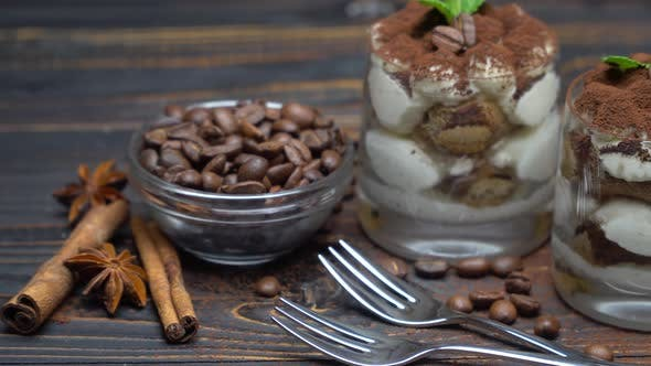 Cover Image for Two Portions Classic Tiramisu Dessert in a Glass on Wooden Background
