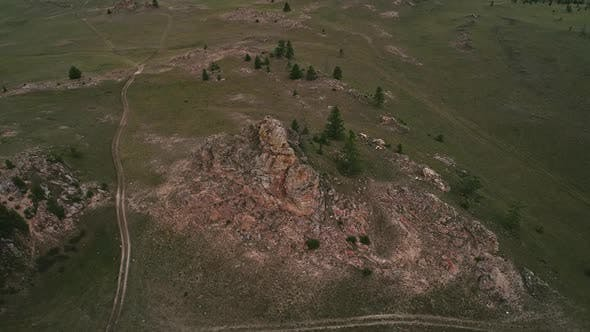 Cover Image for Baikal Valley spirits,Tazheran Steppe, Stone Cliffs on the Road. Aerial Summer