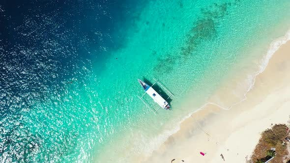 Thumbnail for Beautiful drone travel shot of a sunshine white sandy paradise beach and turquoise sea background