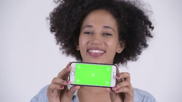 Thumbnail for Face of Young Happy African Woman Showing Phone