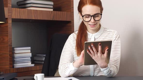Thumbnail for Young Successful Businesswoman Works with a Tablet in Living Room at Home Office