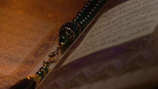 Thumbnail for Holy Quran On Book Rest With Prayer Beads